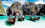 Passenger boats anchored near the beach at popular and beautifull Phi Phi island, Thailand.
