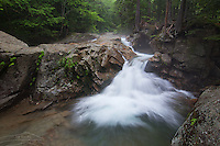 Mist forms along the Pemigewasset on a humid summer day at the Basin in Franconia Notch, NH.