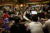 Macanese and other tourists play baccarat at the casino floor of the Venetian Macau Resort Hotel in Macau, China.