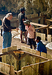 Mike Morwood discusses excavations with local diggers at Liang Bua cave.