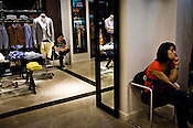 Chinese shoppers seen inside a designer store at The Venetian Macau Resort Hotel in Macau, China.