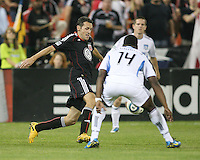 Carlos Verela #11 of D.C. United moves past Brandon McDonald #14 of the San Jose Earthquakes during an MLS match at RFK Stadium in Washington D.C. on October 9 2010. San Jose won 2-0.