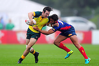 Liam McNamara of Australia takes on the Spain defence. FISU World University Championship Rugby Sevens Men's Semi Final between Australia and Spain on July 9, 2016 at the Swansea University International Sports Village in Swansea, Wales. Photo by: Patrick Khachfe / Onside Images