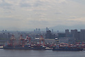 May 23, Tokyo, Japan - Container ships are docked at a cargo area at a port in Tokyo. According to the Ministry of Finance Japan report, the country acquired a trade balance of 520.27 billion yen in April, compared with 470.8 billion yen in the previous year. Exports increased 7.9 percent from a year earlier which was below the expected 11.8 increase economists had hoped for. Imports, on the other hand, saw a 8.0 percent increase to 6.087 trillion yen. (Photo by: Christopher Jue/AFLO)
