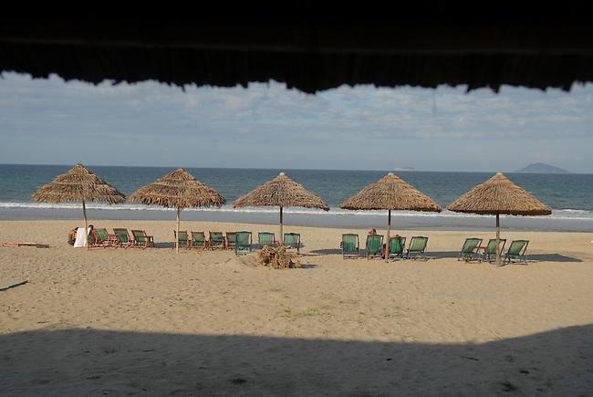 Beach umbrellas at a tourist resort in Hoi An, Vietnam.