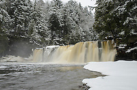 A winter view of the majestic Manabezho Falls on the Presque Isle River in the Porcupine Mountains.