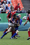 30 April 2005: Philadelphia's Anasa Koroitamana passes the ball as he is tackled. The Kansas City Blues defeated the Philadelphia Whitemarsh RFC 41-14 at the Arrowhead Stadium in Kansas City, Missouri in a Rugby Super League regular season game. .