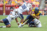 Landover, MD - September 23, 2016: West Virginia Mountaineers wide receiver Daikiel Shorts (6) gets tackled  by serval BYU Cougars defenders during game between BYU and WVA at  FedEx Field in Landover, MD.  (Photo by Elliott Brown/Media Images International)