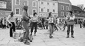 The York Street Band playing in York, March 1979.  Dena Attar on saxophone, Sarah Kemp on washboard, then the three members of the YSB: Sarha Moore (sticks), Anthea Gomez (accordian) and Ros Davies (tin whistle).  Sarha Moore and Ros Davies went on to play in The Bollywood Band, and Ros also joined the Grand Union Band, in London.  Anthea Gomez went on to write and play music for the theatre and then BBC Drama before changing direction.