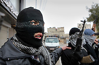 Disguised members of the Free Syrian Army, an armed group that has risen up against the regime of President Bashar al-Assad, in the Sakba district of Damascus. The Free Syrian Army claims to be predominately made up of deserters from the regular army who objected to being called on to shoot protesting civilians.