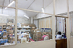 A woman works at the dispensary at Hospital Albert Schweitzer on Thursday, October 28, 2010 in Deschapelles, Haiti.