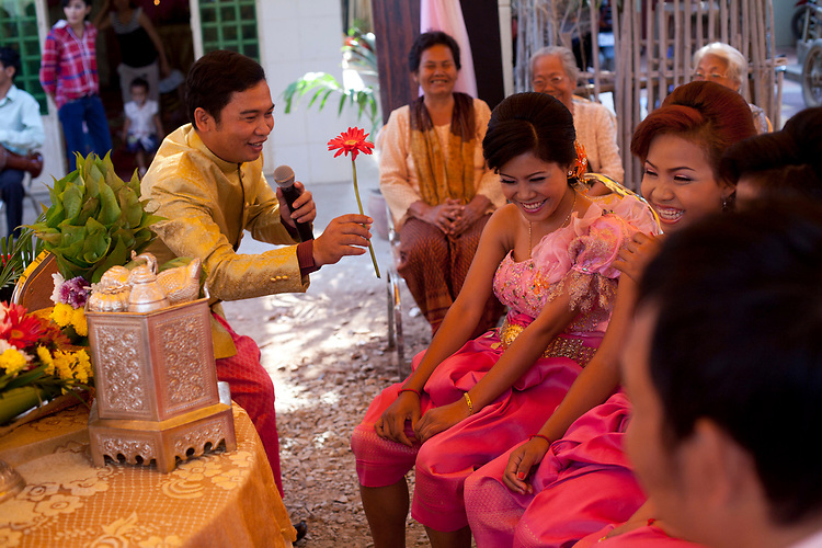 Entertainers at a buddhist wedding in a small village outside of Phnom Penh, Cambodia. <br /> <br /> Photos &copy; Dennis Drenner 2013.