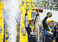 Sep 18, 2016; Concord, NC, USA; NHRA top fuel driver Antron Brown (left) and funny car driver John Force celebrate after winning the Carolina Nationals at zMax Dragway. Mandatory Credit: Mark J. Rebilas-USA TODAY Sports