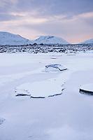 Winter ice of frozen pond on Rannoch Moor, Highlands, Scotland