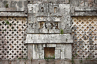 Mask of Tlaloc, god of rain of the Mexican high plateau, Maya hut and lattice work, The Nunnery Quadrangle, South Building, 900-1000 AD, Puuc architecture, Uxmal late classical Mayan site, Yucatan, Mexico Picture by Manuel Cohen