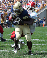 Youngstown State safety Sir Demarco Bledsoe wraps up Pitt running back Dion Lewis. The Pittsburgh Panthers defeated the Youngstown State Penguins 38-3 at Heinz Field on September 5, 2009.