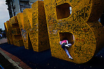 "A girl climbs on a graffittied structure reading ""NEW BORN"" in the center of Prishtina, Kosovo, across from the UNMIK building. The sculpture was unveiled on the day of the declaration of independence from Serbia."