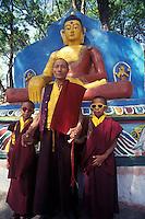 Nepal, Kathmandu. Tibetan monk with his twin grandsons.