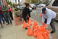 October 28, 2012 (Washington, DC)  Residents of the Bloomingdale neighborhood take sandbags in preparation for Hurricane Sandy.  (Photo by Don Baxter/Media Images International)
