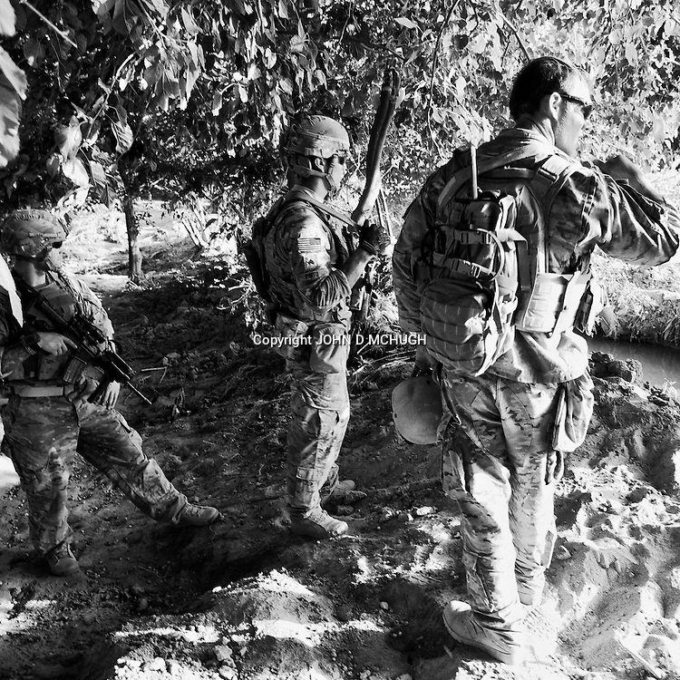 """1 Platoon, Delta Co, 1-66, 4th Infantry Division, patrol an orchard in Arghandab Valley, Kandahar, 01 May 2011, on the day the so called """"Taliban Tet Offensive"""" was due to start. (John D McHugh)"""