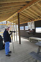 NWA Democrat-Gazette/FLIP PUTTHOFF <br /> A new wildife viewing pavilion is one of improvements at the Eagle Watch Nature Trail at Swepco Lake west of Gentry. The pavilion features shelter from the north wind and is a good spot for a picnic. Terry Stanfill, caretaker of the trail, visits the pavilion Feb. 19 2017 during a photo walk.