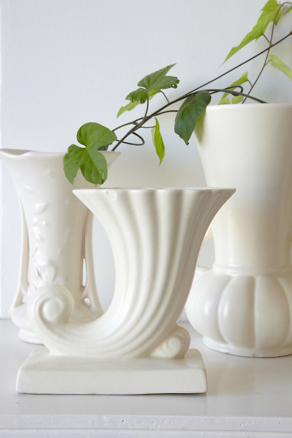 White Vases on white mantel