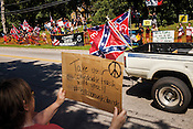 """Hillsborough, North Carolina - August 8, 2015 - Orange County Taking Back Orange County rally attendees and protestors take sides Saturday August 8, 2015 near the Hillsborough Town Hall complex in Hillsborough, North Carolina. The rally, which was prompted by the potential removal of the word """"Confederate"""" from the Orange County Historical Museum, remained peaceful."""