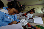 Safina Karamad, left, and other students studying in a school for poor children held in St. Mathew's Church in the Punjab village of Bajasinsingh. This school is sponsored by the Church of Pakistan.