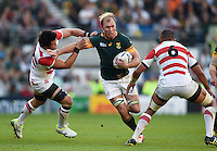 Schalk Burger of South Africa takes on the Japan defence. Rugby World Cup Pool B match between South Africa and Japan on September 19, 2015 at the Brighton Community Stadium in Brighton, England. Photo by: Patrick Khachfe / Onside Images