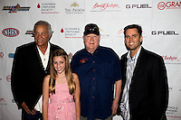 Aug. 29, 2013; Avon, IN, USA: (From left) Don Prudhomme , Alanna Dixon , Tom McEwen and NHRA driver Larry Dixon on the red carpet prior to the premiere of Snake & Mongoo$e at the Regal Shiloh Crossing Stadium 18. Mandatory Credit: Mark J. Rebilas-