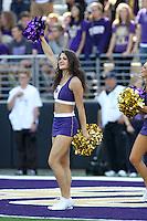 2013-09-21: Washington cheerleader Kristina Koumaeva entertained fans during the game  against Idaho State.  Washington won 56-0 over Idaho State in Seattle, WA.