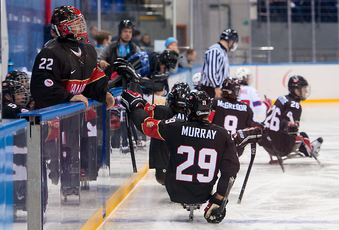 Sochi, RUSSIA - Mar 9 2014 -  Graeme Murray skates by the benched after a goal during Canada vs. Norway at the 2014 Paralympic Winter Games in Sochi, Russia.  (Photo: Matthew Murnaghan/Canadian Paralympic Committee)