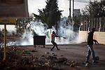 Palestinian demonstrators throw stones towards Israeli security forces during clashes following a rally against the restrictions on the Al-Aqsa mosque compound, in the West Bank village of Silwad, near Ramallah on October 31, 2014. Clashes erupted in the West Bank Friday after weekly Muslim prayers while security forces deployed heavily around Jerusalem's flashpoint Al-Aqsa mosque which reopened following the killing of a Palestinian by police. Photo by Shadi Hatem