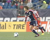New England Revolution midfielder Scott Caldwell (6) on offense. In a Major League Soccer (MLS) match, the New England Revolution (blue) defeated Toronto FC (red), 2-0, at Gillette Stadium on May 25, 2013.