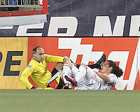 Real Salt Lake forward Devon Sandoval (49) inadvertently takes down an assistant referee. In a Major League Soccer (MLS) match, Real Salt Lake (white)defeated the New England Revolution (blue), 2-1, at Gillette Stadium on May 8, 2013.