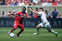 Chicago midfielder Patrick Nyarko (14) maneuvers around pressure by LA Galaxy forward Robbie Keane (2).  The LA Galaxy defeated the Chicago Fire 2-0 at Toyota Park in Bridgeview, IL on July 8, 2012.