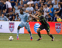 C.J. Sapong, Patrick Ianni. Sporting Kansas City won the Lamar Hunt U.S. Open Cup on penalty kicks after tying the Seattle Sounders in overtime at Livestrong Sporting Park in Kansas City, Kansas.