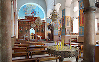 Interior of St George's Church, Madaba, Jordan. On the floor of this Greek Orthodox church, behind the barrier, is the 6th century Byzantine Madaba Mosaic Map. The mosaic is made of 2 million pieces of coloured stone and depicts the Holy Land. It was made 542-570 AD and is the oldest geographic floor mosaic in the world. It was rediscovered in 1884 when the current church was built. Picture by Manuel Cohen