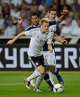 FUSSBALL Nationalmannschaft Freundschaftsspiel:  Deutschland - Argentinien             15.08.2012 Marco Reus (vorn, Deutschland) gegen Ezequiel Gago (Argentinien)