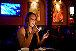 Goldie, a sex worker at the Mustang Ranch brothel, waits for customers December 2, 2009 in Mustang, NV.