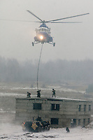 Krasnoarmeysk, Moscow Region, Russia, 29/10/2010..Russian special forces use a helicopter and an armoured personnel carrier to storm a building during a training exercise at a military base outside Moscow. The exercise was part of the Interpolitex 2010 state security exhibition.