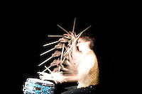 A drummer shows off his drum moves.  A special stroboscopic camera records the motion.  The record of the motion can be analyzed to show both the timing and range of the motion.  This type of image is very important in the science of biomechanics.