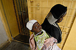 A woman and her daughter leave a clinic run by the Catholic Church in Nyala, where displaced persons are reated.
