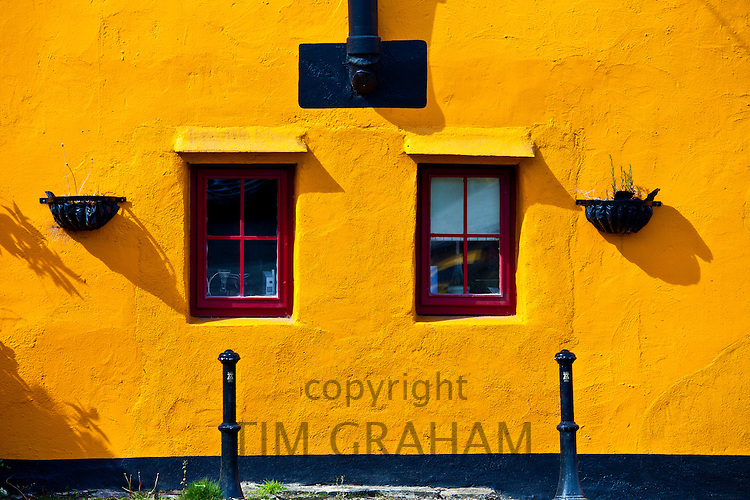 Brightly coloured exterior in terracotta colours of orange and red, Kinsale, County Cork, Ireland