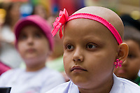 Isabela Osorio a patient with cancer waits for her new wig during a donation ceremony as a commitment to actively fight against cancer in Medellin, Colombia, May 25, 2012.  Colombia celebrated on 31 January, 7, 14 and 21 February some days of donating hair in Beauty Centres Fundayama ALQVIMIA and foundation (Foundation for support and support people with breast cancer), it received 300 donations of hair with which they made 200 wigs  Photo by Fredy Amariles/View