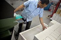 "An Amity Printing Company employee arranges newly-bound Bibles in the Amity Printing Company's new printing facility in Nanjing, China....On May 18, 2008, the Amity Printing Company in Nanjing, Jiangsu Province, China, inaugurated its new printing facility in southern Nanjing.  The facility doubles the printing capacity of the company, now up to 12 million Bibles produced in a year, making Amity Printing Company the largest producer of Bibles in the world.  The company, in cooperation with the international organization the United Bible Societies, produces Bibles for both domestic Chinese use and international distribution.  The company's Bibles are printed in Chinese and many other languages.  Within China, the Bibles are distributed both to registered and unregistered Christians who worship in illegal ""house churches."""
