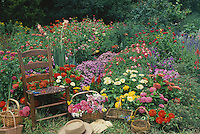 Hickory chair in annual flower garden