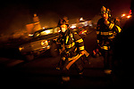 SAN BRUNO, CA - SEPTEMBER 9: Firefighters mop-up September 9, 2010 in a San Bruno, California residential street. A massive explosion rocked a neighborhood near San Francisco International Airport.