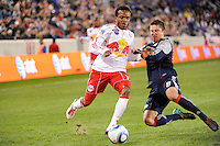 Dane Richards (19) of the New York Red Bulls is defended by Chris Tierney (8) of the New England Revolution during a Major League Soccer (MLS) match at Red Bull Arena in Harrison, NJ, on October 21, 2010.