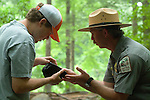 South Carolina Park Ranger and Mountain Bridge Wilderness Naturalist Tim Lee Discusses Freshwater Bio-Diversity with a Converse College Student along the Middle Saluda River, Jones Gap State Natural Area, South Carolina.